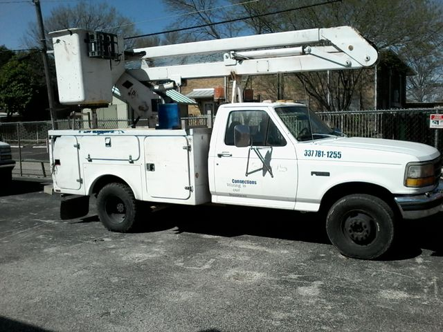 Photo 1997 Ford F-Super Duty Chassis Cab bucket Lift Truck