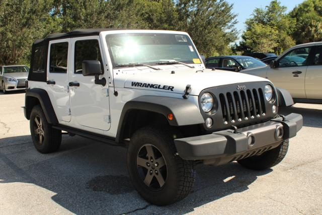 Photo Pre-Owned 2016 Jeep Wrangler Unlimited Black Bear Sport Utility