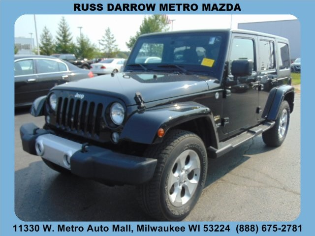 Photo 2014 Jeep Wrangler Unlimited Sahara 4x4 SUV For Sale in Madison, WI