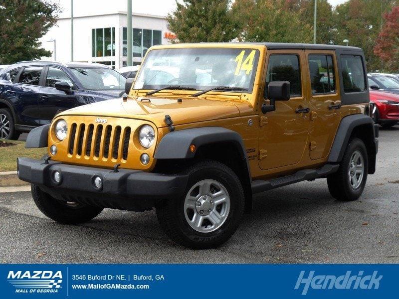 Photo 2014 Jeep Wrangler Unlimited Sport RHD Convertible in Franklin, TN