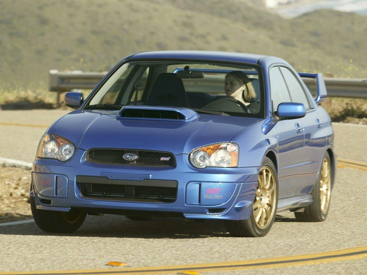 Photo Used 2004 Subaru Impreza WRX STi Base wGold-Painted Wheels for Sale in Tacoma, near Auburn WA