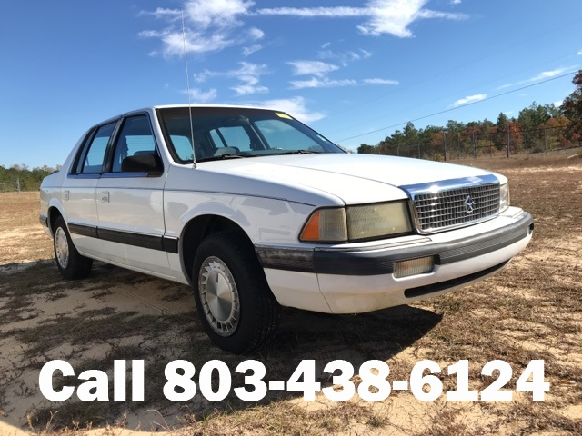 Photo Pre-Owned 1990 Plymouth Acclaim Base FWD 4D Sedan