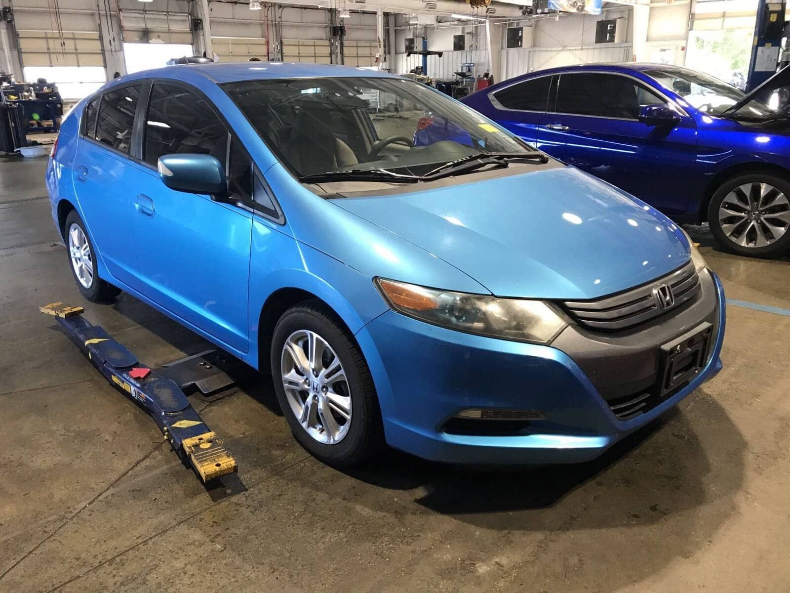 Photo Pre-Owned 2010 Honda Insight EX Hatchback in Fort Pierce FL
