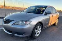 2006 Mazda Mazda3 4dr Sdn i Touring Manual