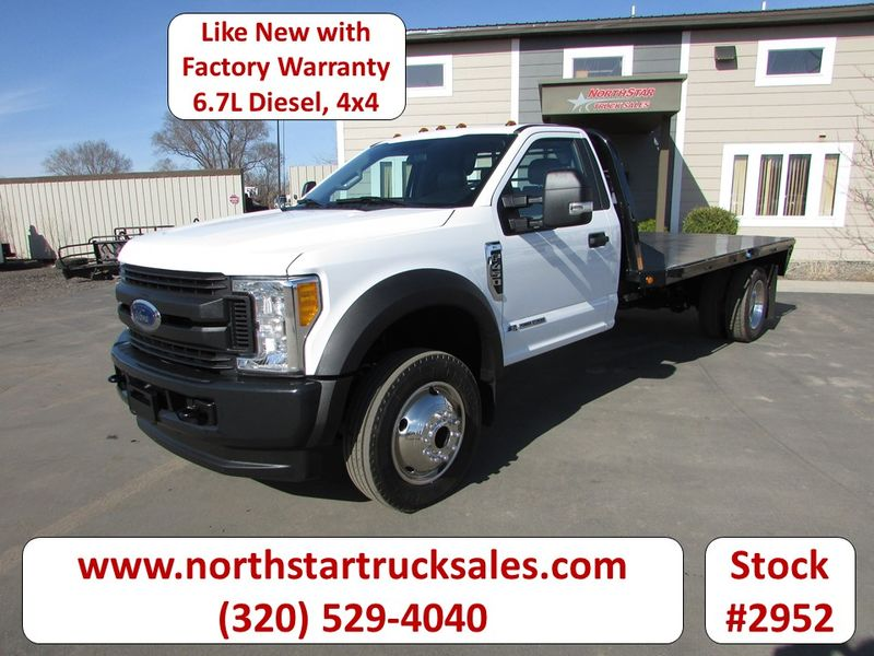 Photo Used 2017 Ford F-450 4x4 6.7 Flat Bed Truck