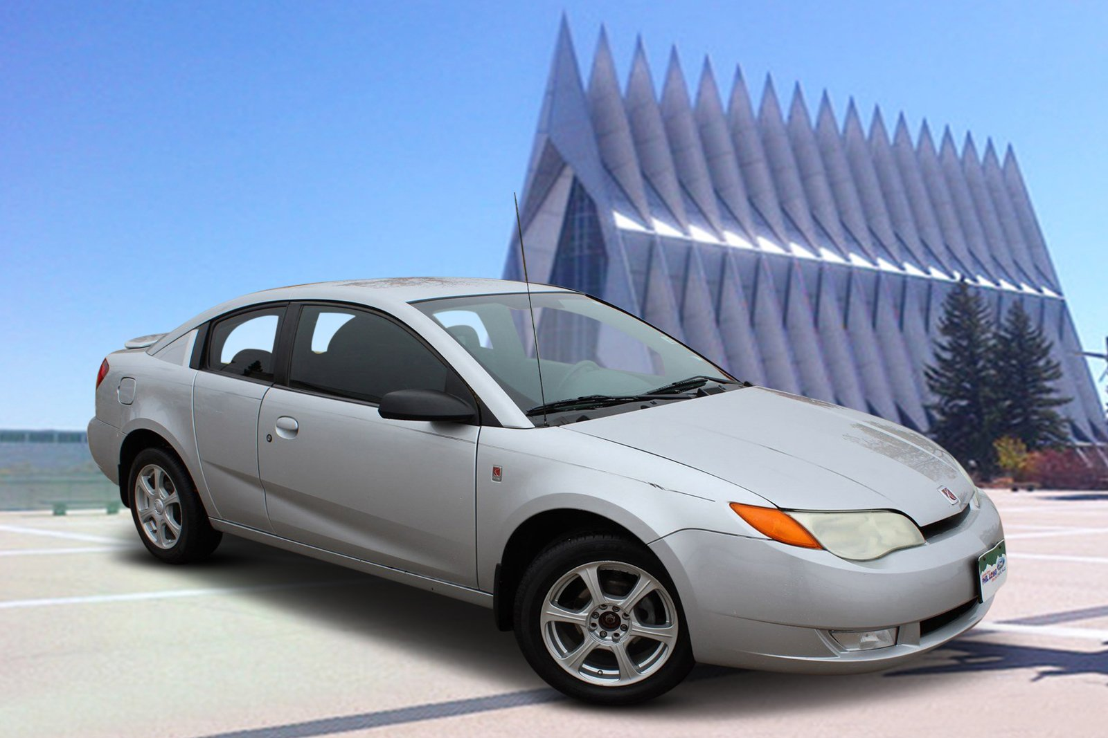 Photo Pre-Owned 2004 Saturn Ion ION 3 FWD 2dr Car