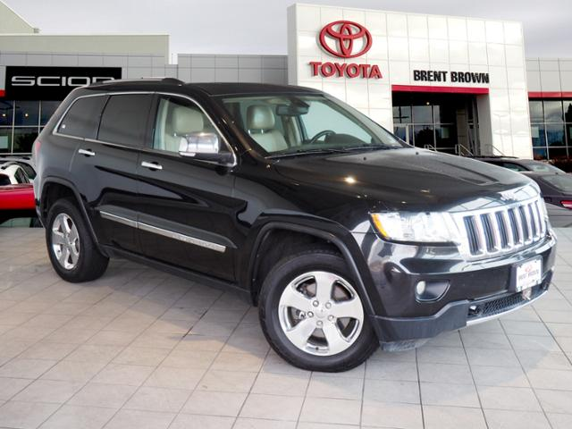 Photo Pre-Owned 2013 Jeep Grand Cherokee Limited 4WD Sport Utility