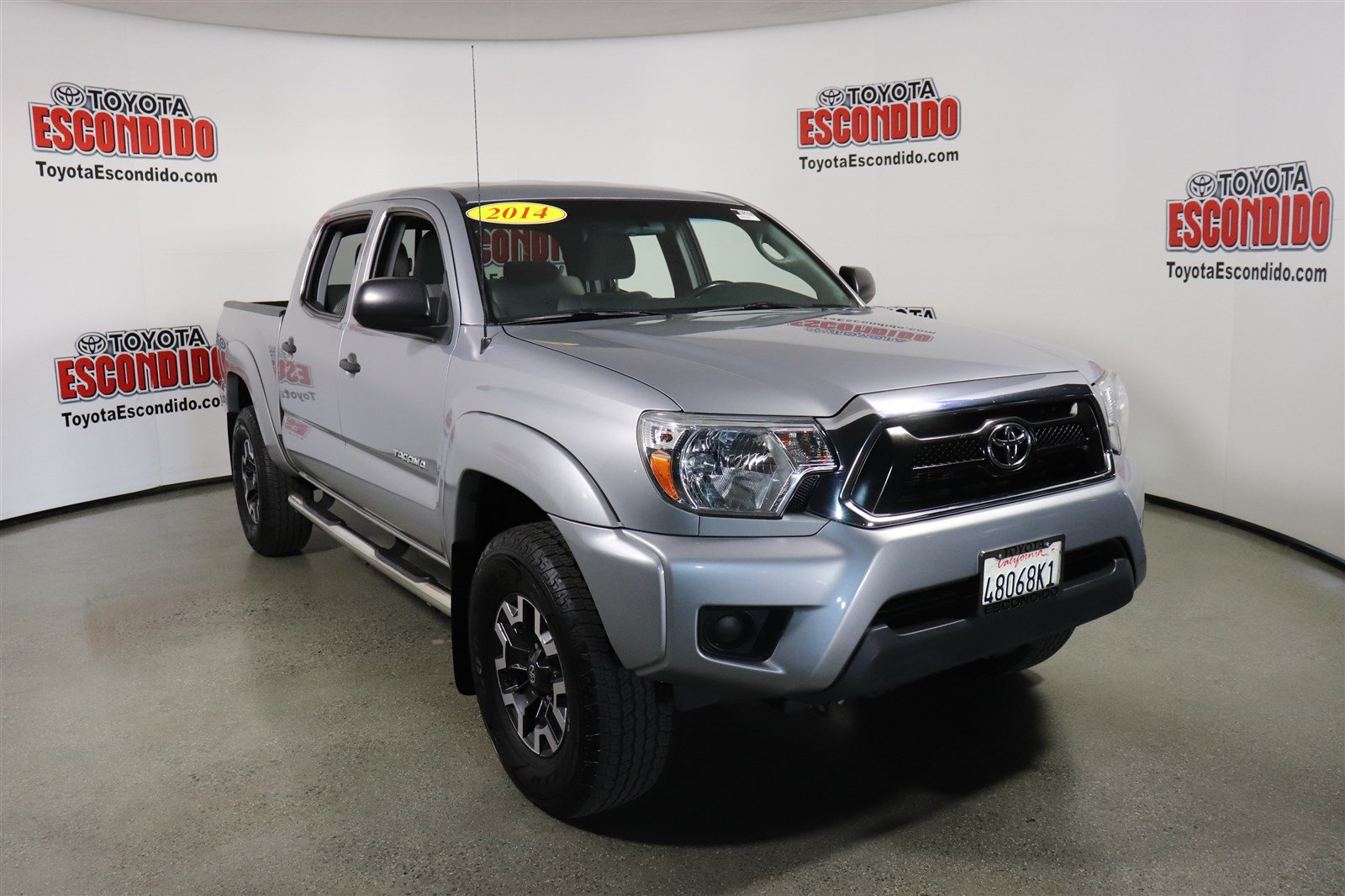 Photo Certified Pre-Owned 2014 Toyota Tacoma 2WD Double Cab I4 AT PreRunner