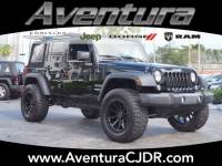 PRE-OWNED 2016 JEEP WRANGLER SPORT 4WD