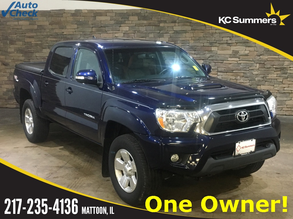 Photo Pre-Owned 2012 Toyota Tacoma TRD 4WD