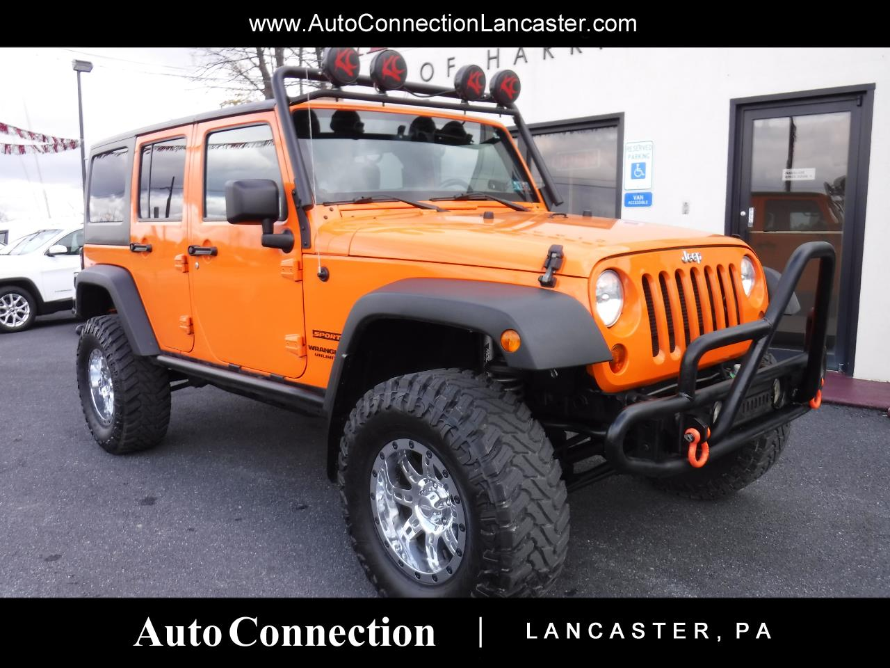 Photo 2013 Jeep Wrangler Unlimited 4WD 4dr Sport LIFTED