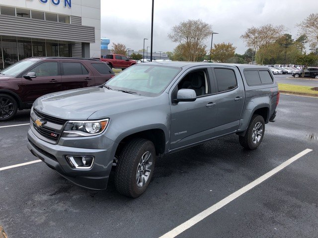Photo Used 2018 Chevrolet Colorado Crew Cab Z71 LOW LOW MILES CAMPER SHELL INCLUDED Pickup
