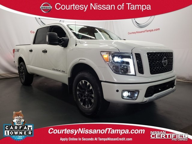 Photo Pre-Owned 2019 Nissan Titan PRO-4X Truck Crew Cab in Jacksonville FL