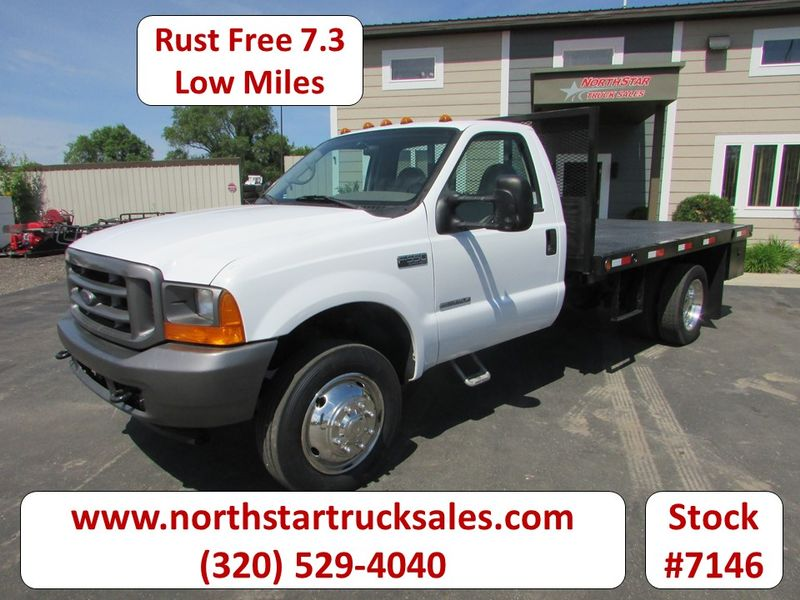 Photo Used 2001 Ford F-550 7.3 Flatbed Truck