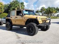 Pre-Owned 2013 Jeep Wrangler Unlimited Sport SUV in Jacksonville FL
