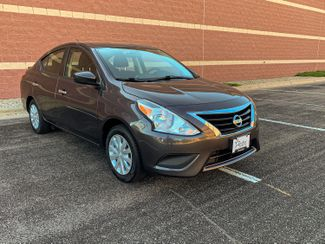 Photo 2015 Nissan Versa SV 6 mo 6000 mile warranty