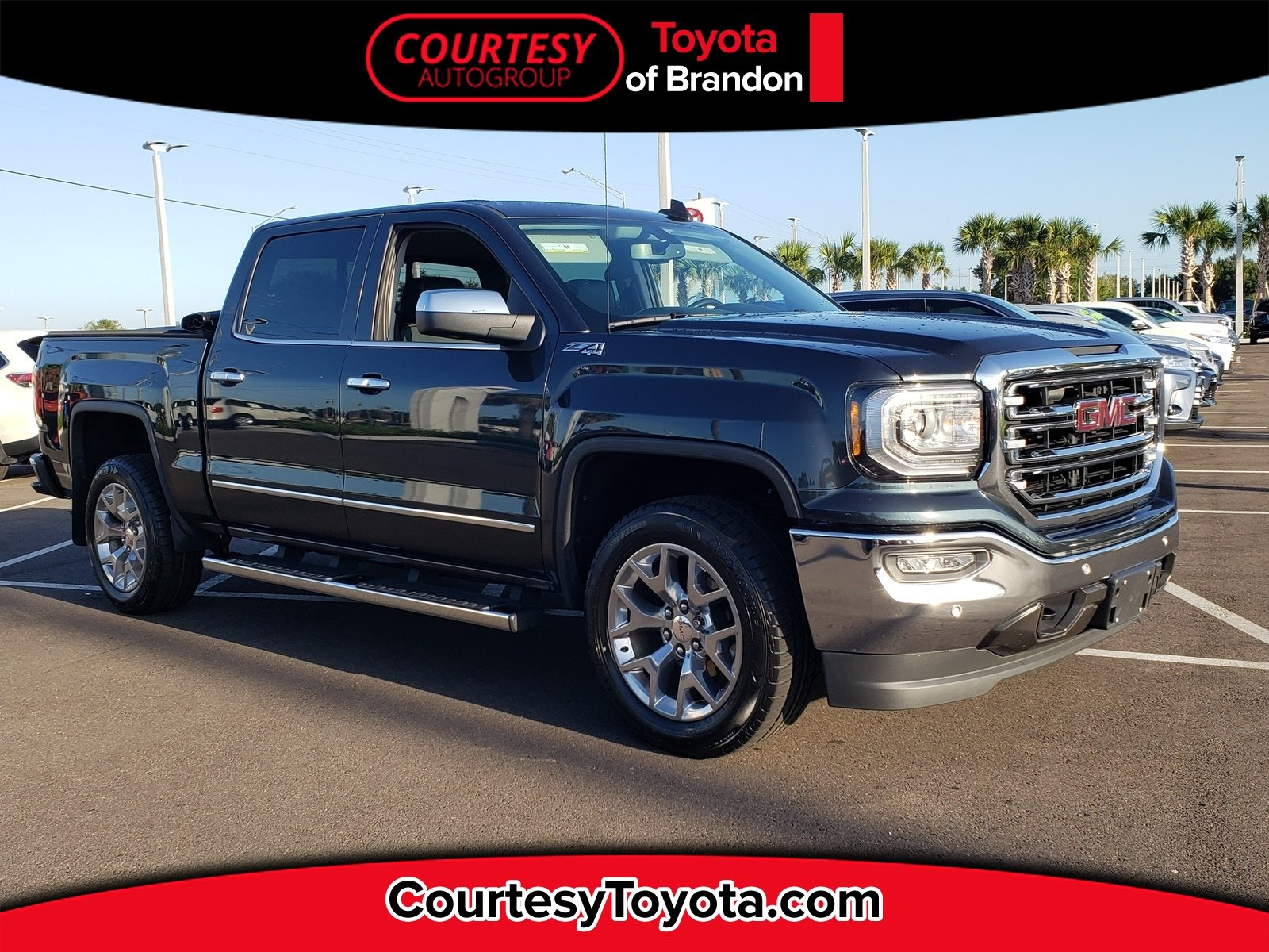 Photo Pre-Owned 2018 GMC Sierra 1500 SLT Truck Crew Cab in Jacksonville FL