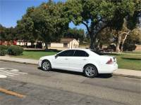 White Ford Fusion SEL