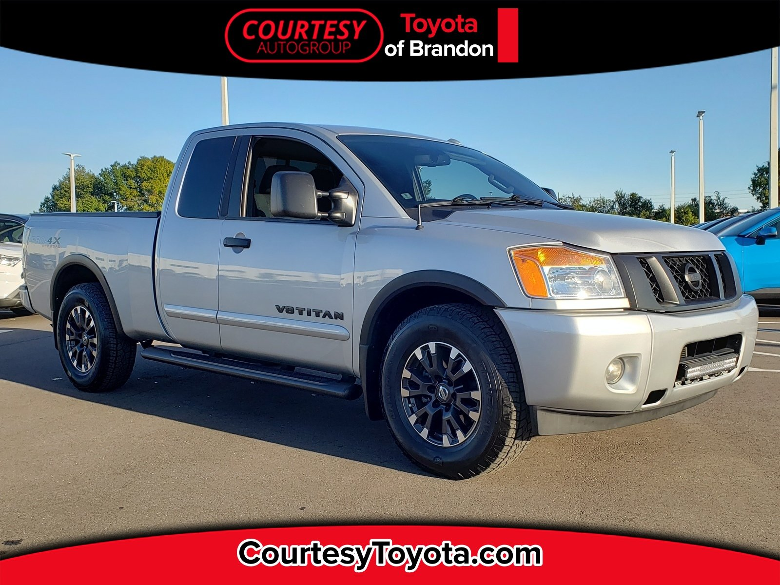 Photo Pre-Owned 2014 Nissan Titan SV Value Truck Package Truck King Cab in Jacksonville FL
