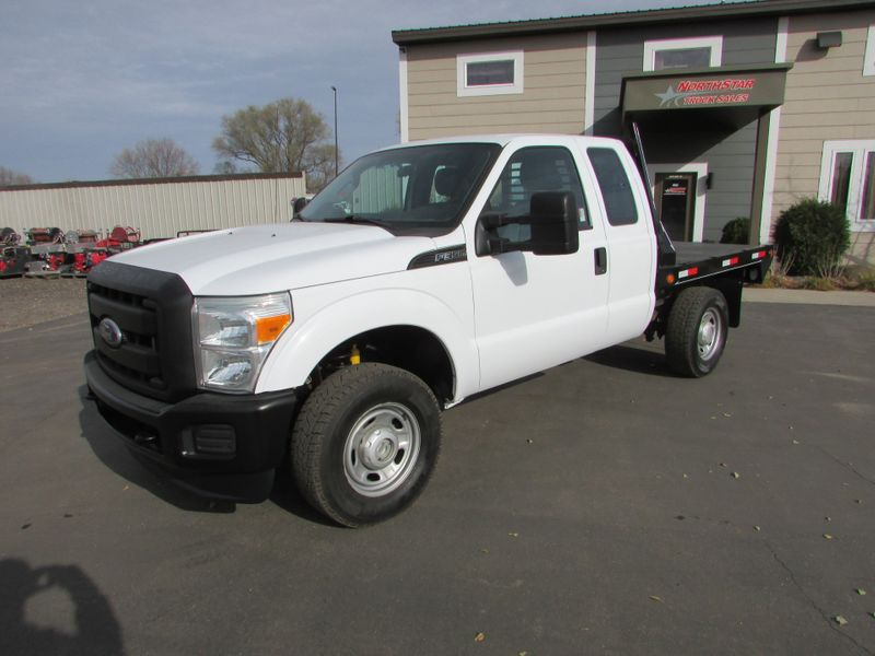 Photo Used 2011 Ford F-350 4x4 Ex-Cab Flat-Bed Truck