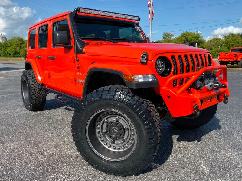 Photo Used 2019 Jeep Wrangler Unlimited AGENT ORANGE CUSTOM LIFTED SAHARA LEATHER