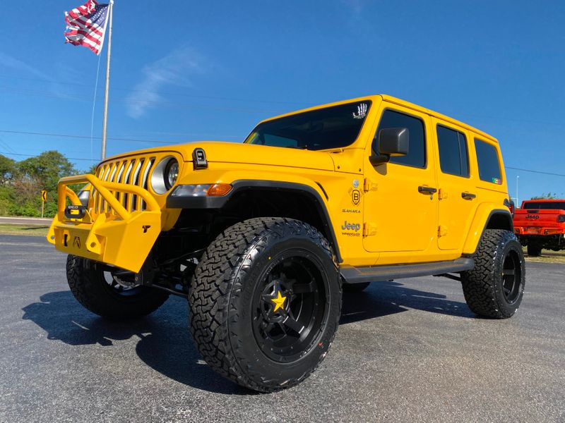 Photo Used 2019 Jeep Wrangler Unlimited HELLA YELLA CUSTOM LIFTED LEATHER SAHARA