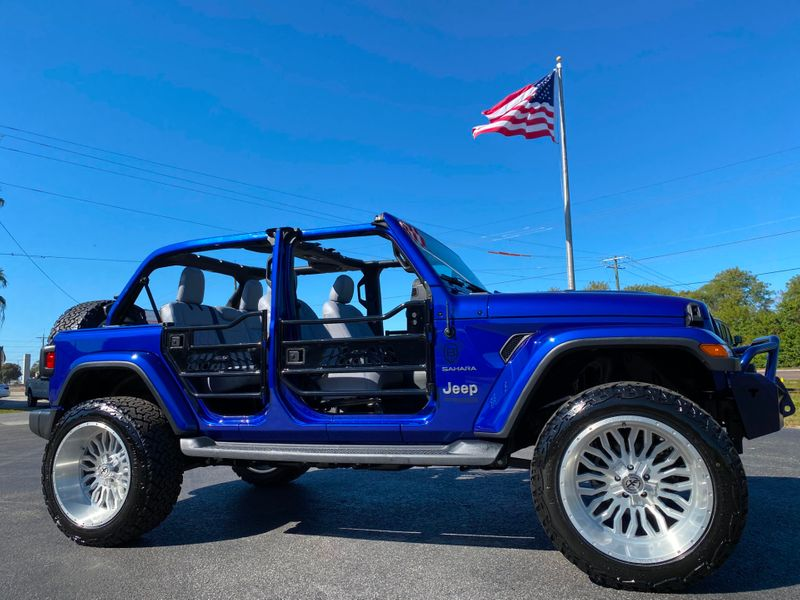 Photo Used 2019 Jeep Wrangler Unlimited CUSTOM LIFTED SAHARA LEATHER NAV FAB FOUR