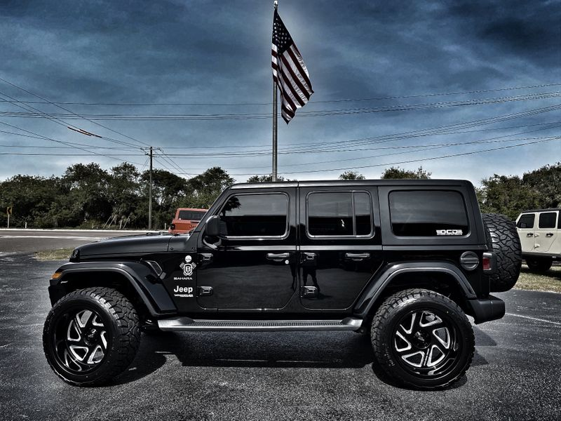 Photo Used 2019 Jeep Wrangler Unlimited CUSTOM LIFTED BLACK-OUT SAHARA FAB FOUR MOTO
