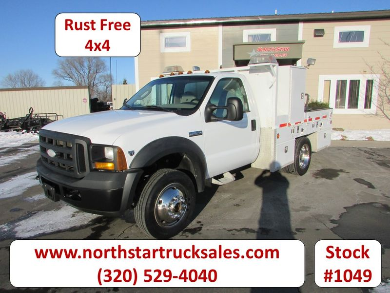 Photo Used 2007 Ford F-550 4x4 Flatbed Truck