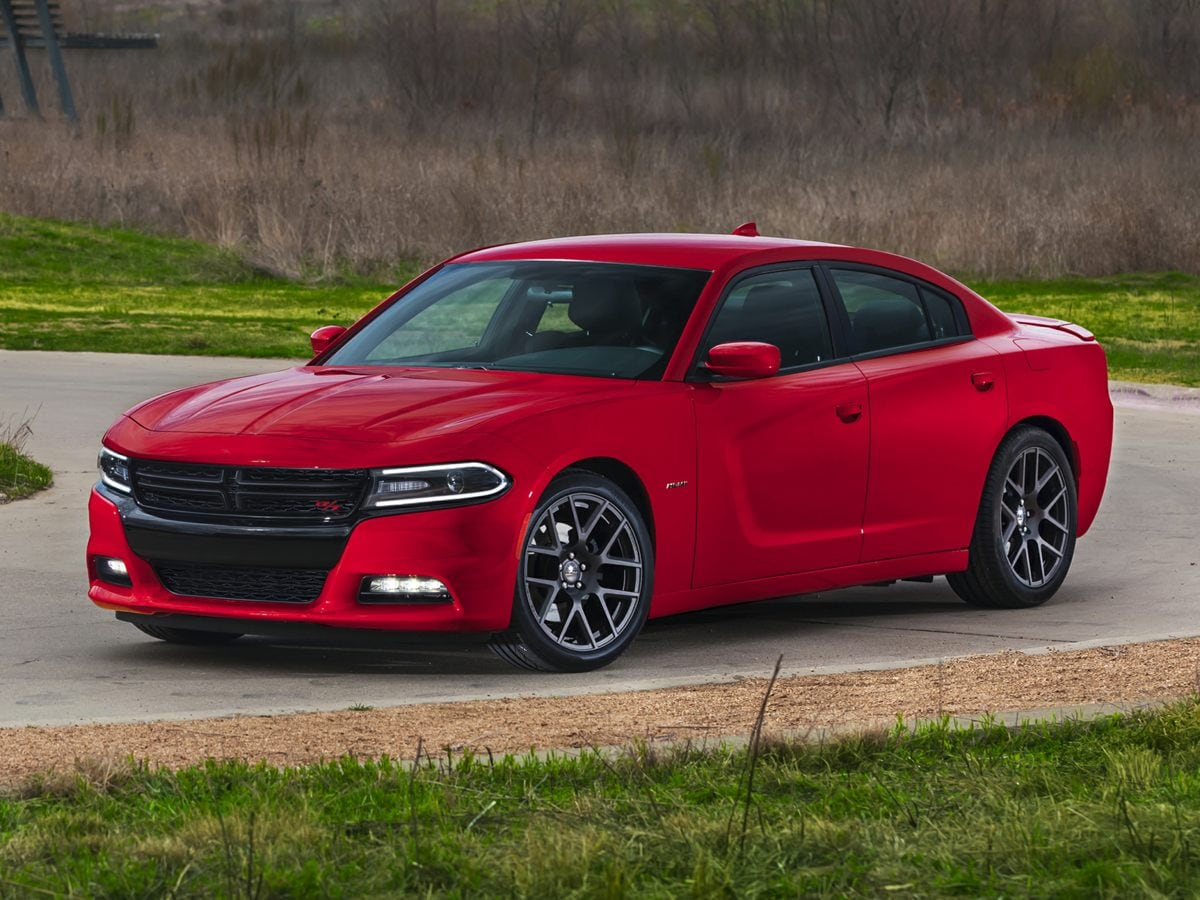 Photo 2015 Dodge Charger SE Sedan In Clermont, FL