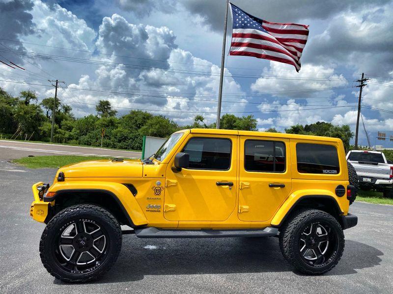 Photo Used 2019 Jeep Wrangler Unlimited HELLAYELLA CUSTOM LIFTED SAHARA LEATHER NAV