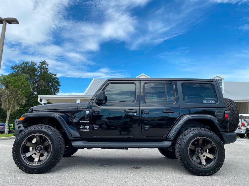 Photo Used 2019 Jeep Wrangler Unlimited BLACK BEAST LIFTED SAHARA LEATHER HARDTOP V6