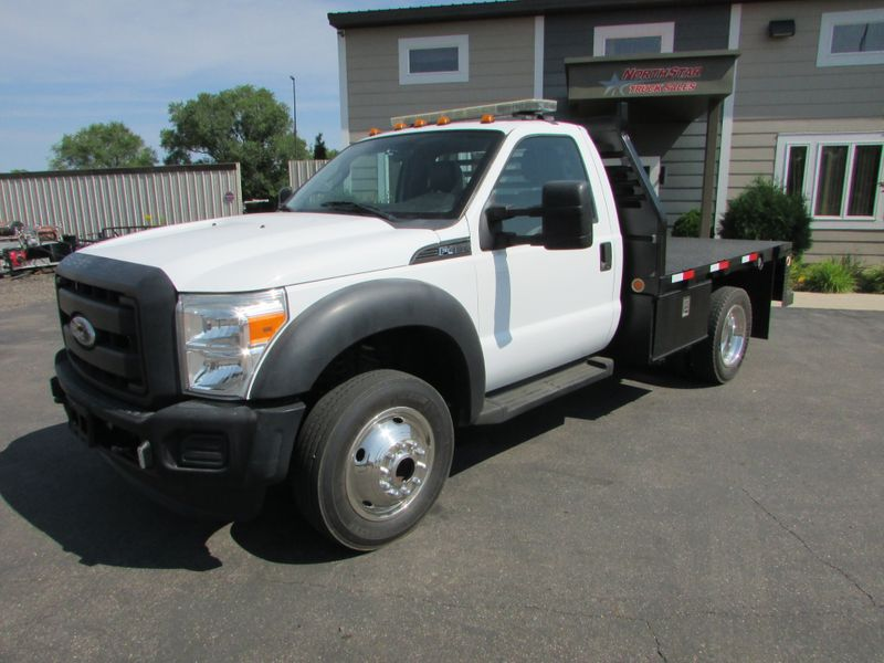 Photo Used 2011 Ford F-450 4x4 Flat-Bed Truck