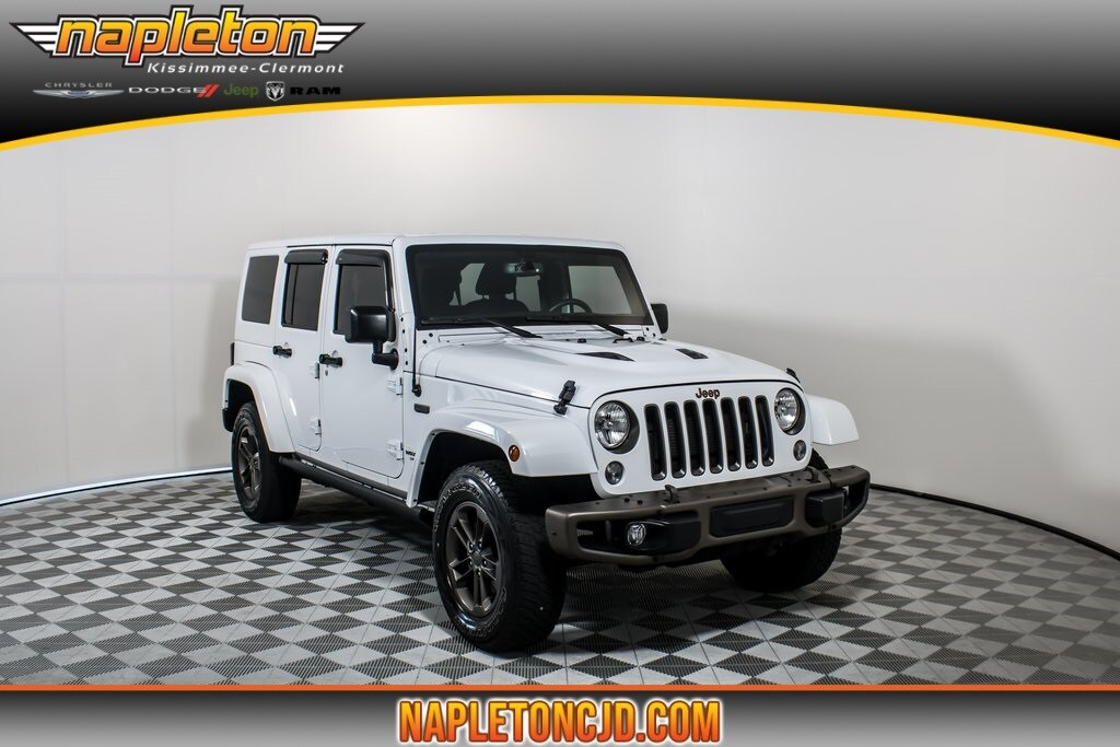 Photo 2016 Jeep Wrangler Unlimited Sahara SUV In Clermont, FL