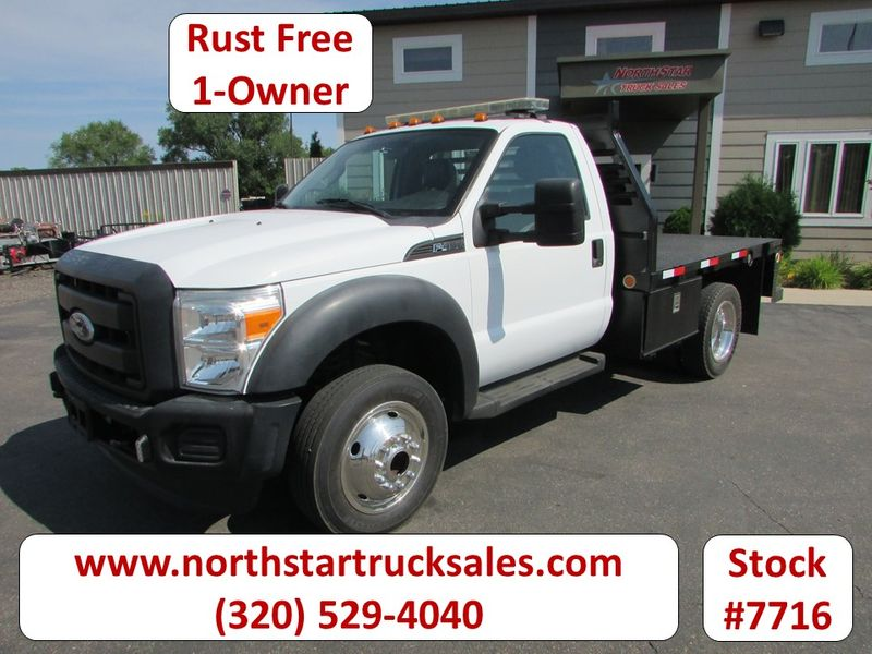 Photo Used 2011 Ford F-450 4x4 Flatbed Truck