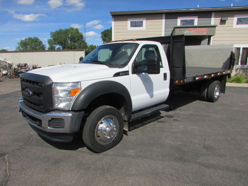 Photo Used 2012 Ford F-450 4x2 Reg Cab Flatbed with Tommy Gate