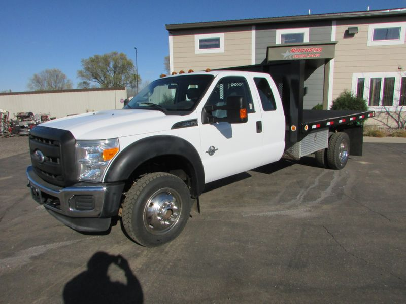 Photo Used 2011 Ford F-550 4x4 Ex-cab Tipper Flat-Bed Truck