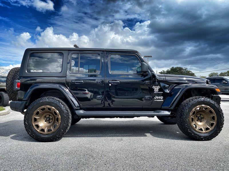Photo Used 2020 Jeep Wrangler Unlimited BLACK N BRONZE SAHARA HARDTOP LEATHER LIFTED
