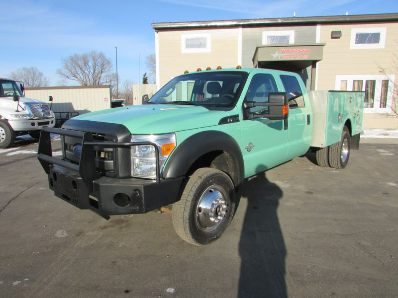 Photo Used 2013 Ford F-450 4x4 Crew-Cab Service Utility Truck XL